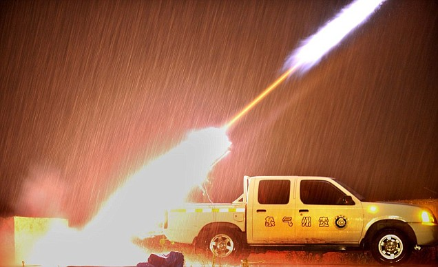Rockets used to seed clouds are fired from the back of a truck in China
