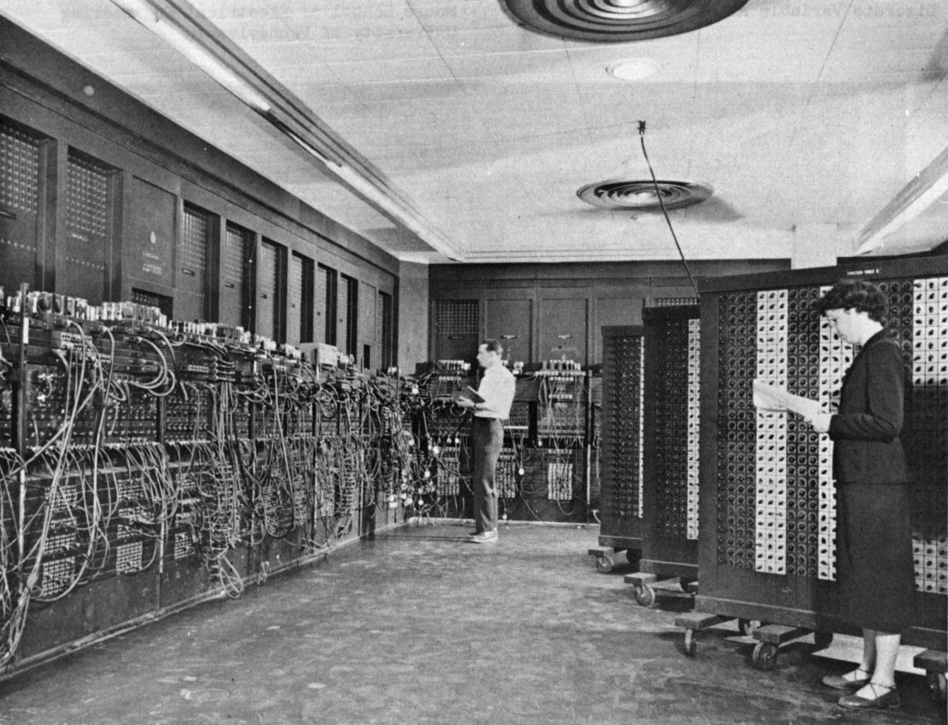 Glen Beck (background) and Betty Snyder (foreground) program ENIAC in BRL building 328. (U.S. Army photo)