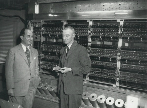 John von Neumann and Robert Oppenheimer standing in front of ENIAC (Electronic Numerical Integrator and Computer)