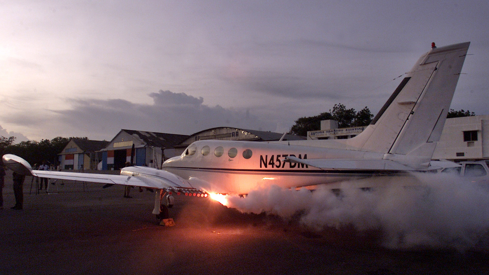 Cloud seeding flares mounted on an aircraft